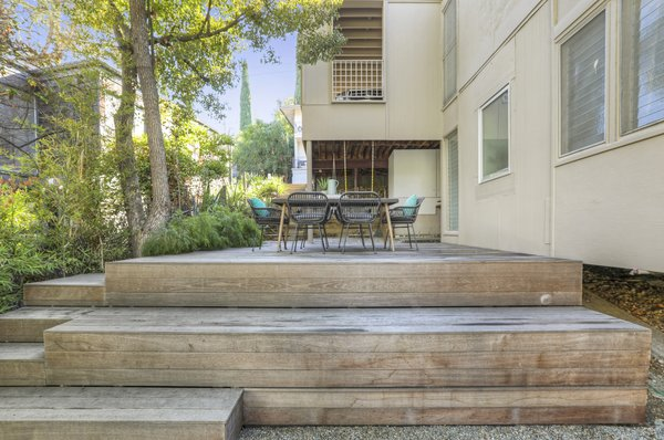 There is a large, low-maintenance Mangaris Diamond hardwood deck in the side yard.