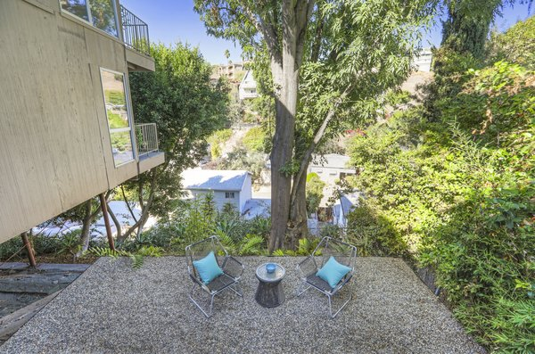 The yard is professionally landscaped with native and drought-tolerant plants. The property boasts mature ash, camphor, and laurel fig trees. There are also peach, apple, cherry, orange, and lemon trees.