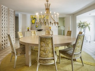The dining area features a circular, custom-designed V'Soke rug and a dinette set that seats eight.