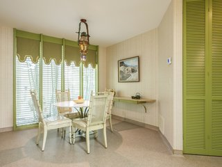 The breakfast nook is a fresh shade of green.