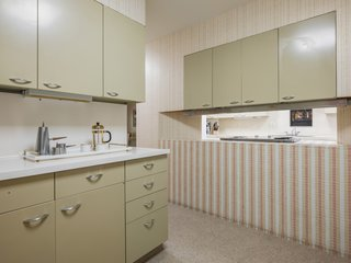 The kitchen maintains all its original midcentury charm.