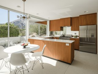 The kitchen has been updated with a vintage vibe and seamlessly integrates into the home's clean midcentury style.
