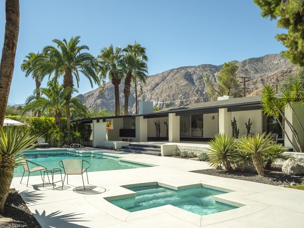 Surrounding by palm trees, the backyard features a pool and spa plus multiple spaces for outdoor entertaining. There are also spectacular mountain views.