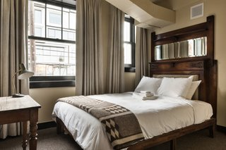 Custom beds were made with vintage fireplaced mantles sourced by architectural salvage shop Aurora Mills.