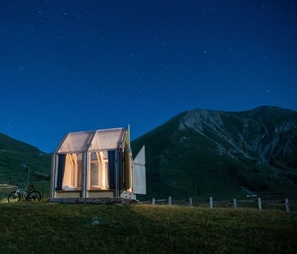 Immerso Glamping, a 65-square-foot prefab structure designed by Italian architects Fabio Vignolo and Francesca Turnaturi, is located in the Piedmont region of Italy. With a simple palette of birch plywood and plexiglass, the cabin was inspired by the architects' experience designing easy-to-assemble, flat-packed cabins for disaster relief. You can book it on Airbnb for around $90.