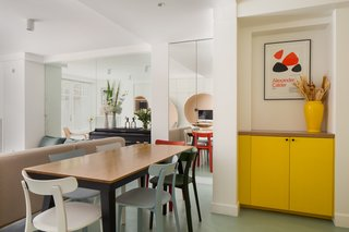 A small dining nook was inserted into the open-plan living space. Additional storage cabinets were squeezed in wherever space allowed.
