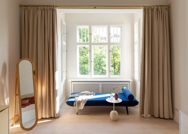 """A window nook becomes the ultimate spot for relaxing with the addition of a Dick Cordemeijer for Auping """"Cleopatra"""" daybed reupholstered in a rich Pierre Frey velvet."""
