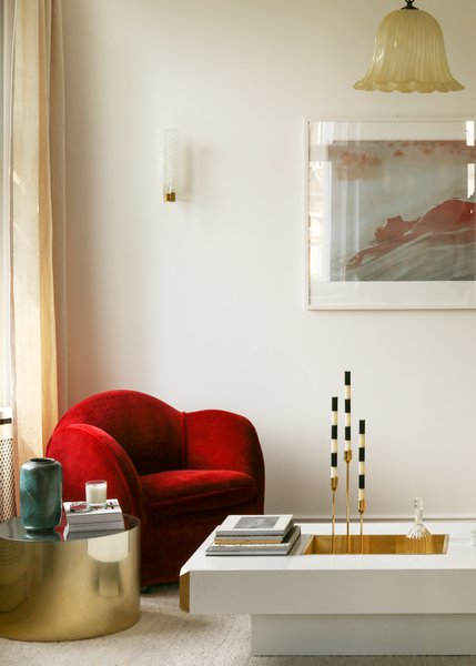 The Vladimir Kagan directional armchair was reupholstered in a lush, red mohair fabric from Pierre Frey. The unique Willy Rizzo coffee table is a glam 1970s piece with a brass basin which was used for ice to keep cocktails and drinks cool.