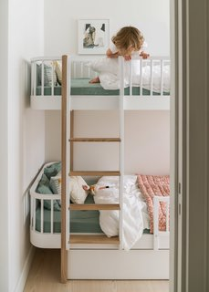 The children's room was the former galley kitchen with bunk beds by Oliver Furniture with rounded edges and storage underneath.
