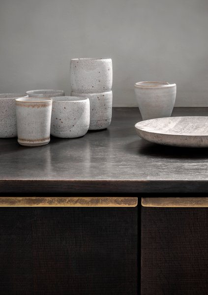 """The surface of the cabinet doors are made from saw cut veneer, which Bjerre-Poulsen says gives the design a very tactile element. """"You can see and feel the groves from the saw on the surface."""""""