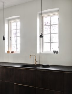 """We wanted to create a kitchen that would develop and become prettier with time. Something that was raw, tactile, and natural. Our kitchen reflects this thought by using materials from nature to carry the design. In Scandinavia, we have a tradition of inviting nature inside, blurring the boundaries between what is inside and outside,"" says Bjerre-Poulsen."