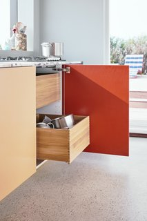The wood drawers that slide out are special upgrades requested by the homeowners. Reform offers different solid wood drawers and options as upgrades for all of their kitchen designs.