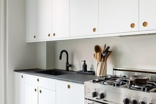 Upgrading an affordable IKEA kitchen with designer fronts and countertops from Reform helped keep the project on budget.
