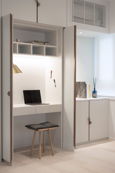 The entire unit is a custom design, fitted with drawers and a writable magnetic surface—just like a proper office.