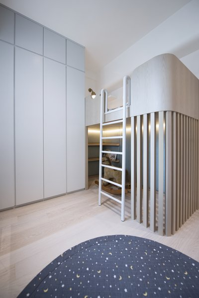 In the child's room, floor-to-ceiling built-in closets maximize storage and a loft bed creates space for a play station underneath.