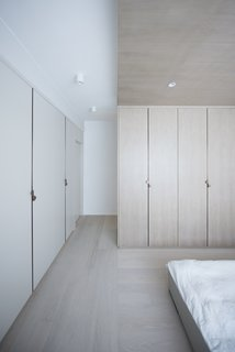 The master bedroom is lined with built-in closets to maximize storage.