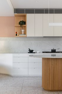 """Terrazzo flooring replaced the existing porcelain tile floor. """"The terrazzo floor is about coming up with this lovely texture that wasn't just polished concrete,"""" explains Carter."""