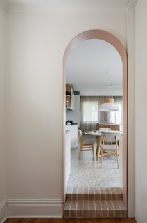 An arched doorway and two brick steps were added to enhance the sense of drama as the new environment unfolds.
