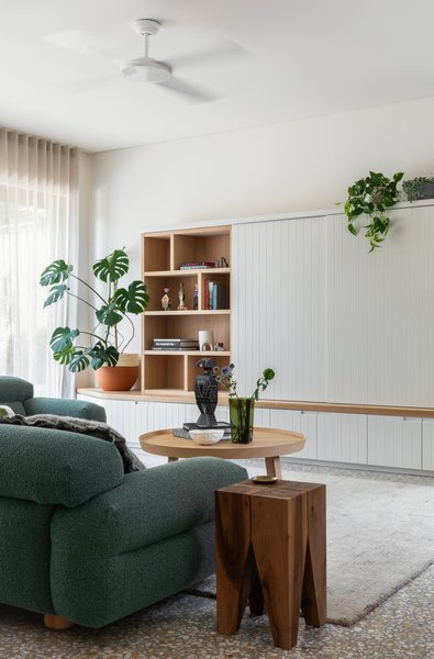 """The clients really didn't want the TV to be the main feature of the living room, so we designed the piece with sliding panels to give the flexibility to hide the TV and reveal a bookshelf in the closed position,"" explains Peake."