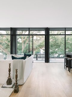 "The upstairs level holds three of the home's four bedrooms and a ""tree room"" surrounded by canopy views."