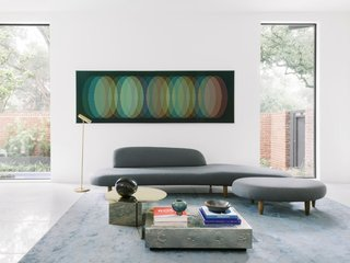 The living room features an Isamu Noguchi Freeform sofa, a brassy Slit Table XL from Hay, and a square silver coffee table from FOUND home by Ruth Davis. The artwork is by Carlos Cruz Diez.