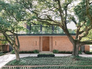 As the midcentury era was winding down, architect George Smart was commissioned to design a low-slung brick and glass house at 2300 Timber Lane in Houston's River Oaks neighborhood. The home would go on to serve as the clergy house for St. Luke's United Methodist Church for 49 years.