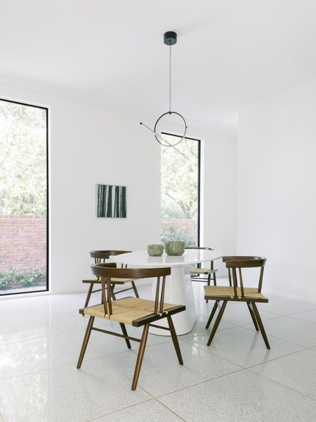 An additional dining area boasts George Nakashima chairs and lighting from Flos.