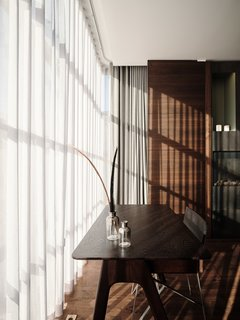 Diaphanous curtains help soften the influx of light.