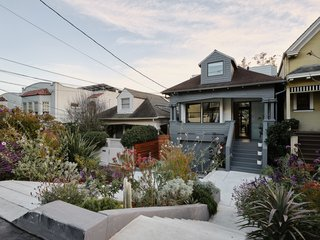 The traditional facade of this Craftsman home in San Francisco's Noe Valley doesn't give away its industrial-inspired interiors and the ultra-modern, glass rear facade. Originally built in 1906, the Valley Street Project was completely reimagined by architect Ross Levy and architect and interior designer Kevin Hackett for a tech entrepreneur, a community organizer, and their two children.