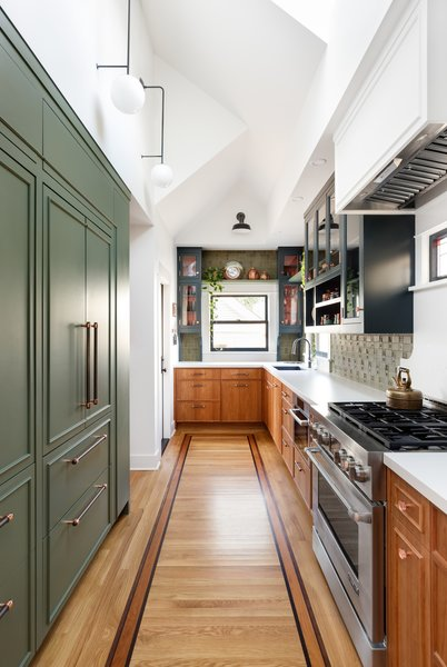 "The renovation made only minor changes to the kitchen's original footprint changes were minimal. However, the entire ceiling was vaulted and skylights were added for additional natural light. ""This was a reaction to the neighbors building an ADU right up to their property line,"