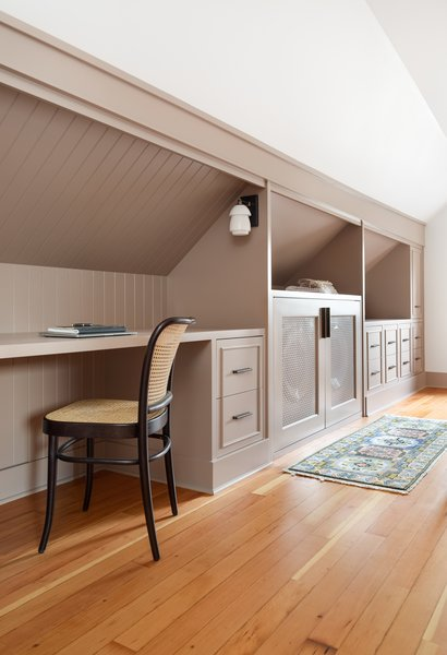 """Stephanie used every inch of crawl space for built-ins so there is a ton of storage,"" shares Hixton. Dyer also added a washer and dryer discretely set behind doors for added convenience for the couple and any future caretaker."