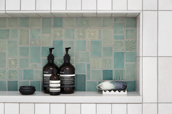 Inside the shower, the tiles for the shelf were made by Jackson.