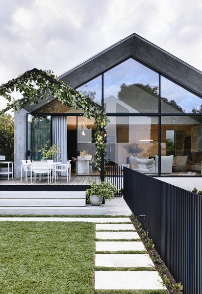 "The back of the home and its soaring glass-and-concrete addition create a strong connection between the indoor and outdoor spaces, and the rear garden and the pool feel like ""a secret refuge."""