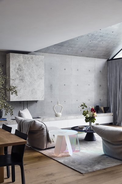 "The color palette of the home also takes its cues from the ""cool, tonal softness of the concrete"". says Kennon."