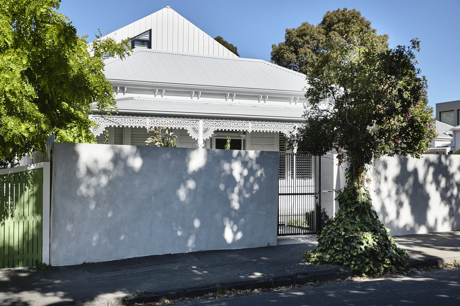 Scandizzo House, Kennon+ Victorian cottage house facade decorative filigree