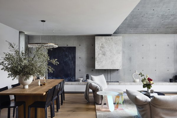 """The dining table is a custom design by architect, Pete Kennon, and paired with 412 Cab chairs by Cassina. The chandelier is from Melbourne-based Industrial Designer Christopher Boots.  <span style=""""color: rgb(204, 204, 204); font-size: 13px;"""">Photo by Derek Swalwell</span>"""