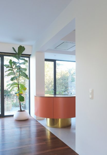 """The round form was a spatial decision,"" shares Otten. ""The client wanted an island in relation to the dining room."""