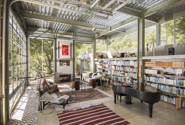 The industrial, steel garage doors open the main home's living room to the surroundings; however, they can also quickly seal the home off from fire.