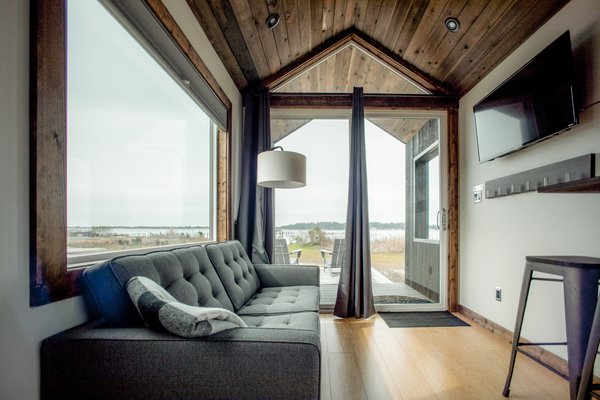 The Kamp Haus cabin interiors are minimalist with large windows that take advantage of the views.