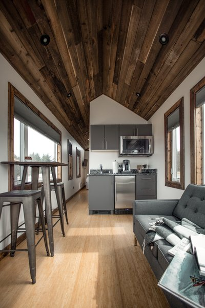 A pitched, tongue-and-groove ceiling adds a rustic feel.