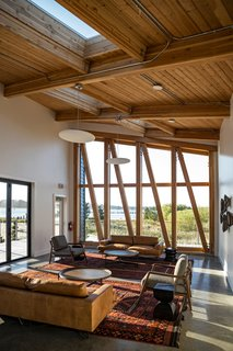 The high, angled ceiling and full-height windows provide perspective on the natural surroundings.