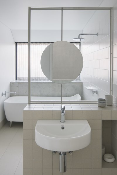 The highlight of one of the upstairs bathrooms for the girls is this custom mirror that can rotate and adjust to their height as they grow.