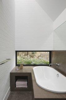 Inax Yohen Border tiles from Artedomus line the master bathtub.