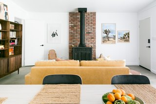A coat of white paint paired with the newly exposed concrete floor gave the room an entirely new feel. For furnishings, Natalie looked for quality pieces that would last, especially since she intended to rent out the cabin as an Airbnb.