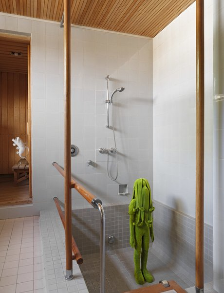 The grand master bath with its Finnish sauna showcase the artwork.