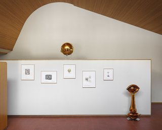 """At the entrance, which is one of the home's most beautiful features, the exhibition starts under Aalto's free-form vaulted ceiling which is made of red pine from Northern Finland. Sketches titled """"Subtle Bodies"""