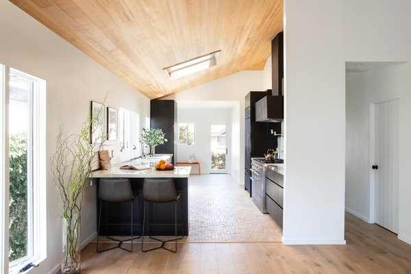 High ceilings and a skylight make the updated kitchen bright and airy.