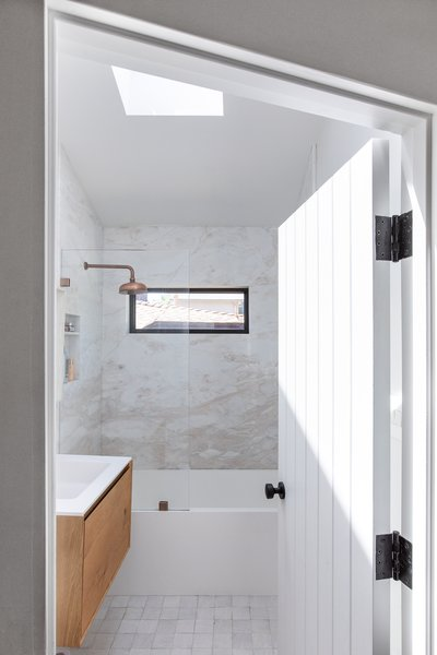 Nwankpa Gillespie added a skylight and brightened the palette with a marble shower and the same Cle zellige tiles featured in the kitchen.