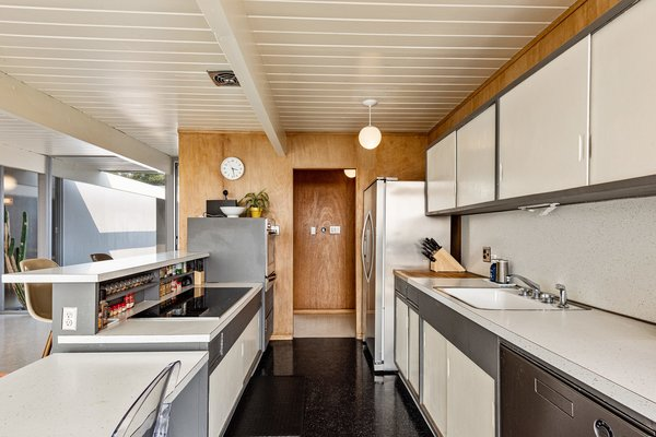 The midcentury kitchen is original, but the appliances have all been updated with high-end models.