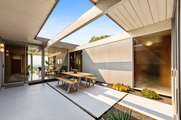 The open-air atrium leads straight into the open-plan living space with views straight out to the backyard.